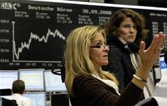 <p>Traders react in front of the DAX board at the Frankfurt stock exchange September 30, 2008. REUTERS/Alex Grimm</p>
