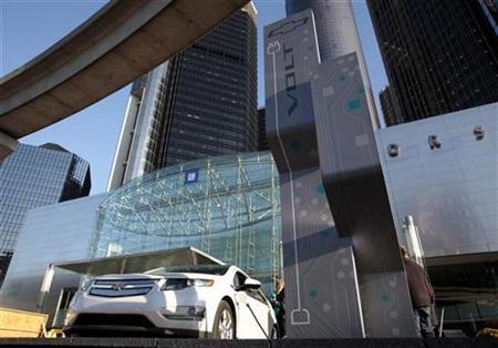 A Chevrolet Volt sits plugged into a newly installed electric charging station outside General Motor Co world headquarters in Detroit, Michigan October 12, 2010. REUTERS/Rebecca Cook