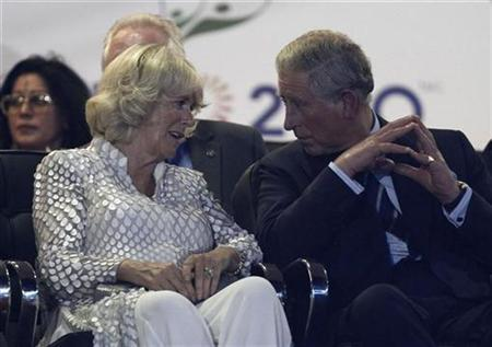 Camilla, Duchess of Cornwall (L) and Britain's Prince Charles speaks during the opening ceremony for the Commonwealth Games at the Jawaharlal Nehru Stadium in New Delhi October 3, 2010. REUTERS/Adnan Abidi