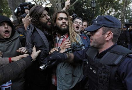 Police block group of demonstrators during an anti-NATO march in downtown Lisbon November 20, 2010. REUTERS/Rafael Marchante