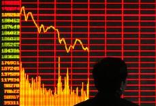 <p>An investor is seen in front of an electronic board showing stock information at a brokerage house in Taiyuan, Shanxi province February 12, 2009. REUTERS/Stringer</p>