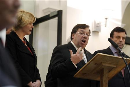 Irish Prime Minister Brian Cowen (2nd R) speaks during a news conference on the steps of Government Buildings, in Dublin November 22, 2010. REUTERS/Cathal McNaughton