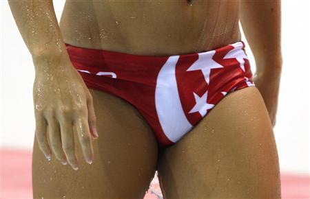 An athlete from Singapore's men's water polo team wears a swimming trunk with the Singaporean flag's white crescent moon detail on the front, at the 16th Asian Games in Guangzhou, Guangdong province, November 25, 2010. REUTERS/Bobby Yip (CHINA - Tags: SPORT WATER POLO SOCIETY)