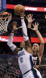 """<p>Центровой """"Орландо"""" Дуайт Ховард забрасывает мяч в корзину """"Майами"""" в Орландо 24 ноября 2010 года. """"Орландо"""" дома добился победы над """"Майами"""" со счетом 104-95 в матче регулярного чемпионата Национальной баскетбольной ассоциации. REUTERS/Kevin Kolczynski</p>"""