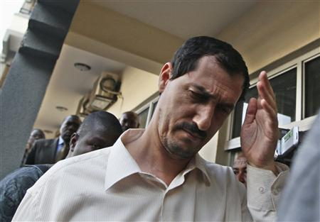 Azimi Adhajani, an Iranian charged for illegal arms importation into Nigeria, walks outside a magistrate court in the federal capital Abuja November 25, 2010. The court on Thursday charged Adhajani, identified in court documents as a Tehran-based businessman and member of Iran's Revolutionary Guard Corps, and three Nigerians over a shipment of mortars and rockets seized in the main port of Lagos last month. REUTERS/Afolabi Sotunde