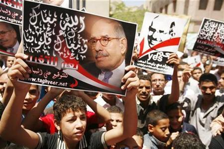 Supporters of former head of the U.N. nuclear agency Mohamed ElBaradei (pictured on posters) chant slogans during a rally in Fayoum, about 100 km (62 miles) south of Cairo, June 4, 2010. REUTERS/Asmaa Waguih