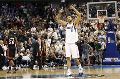 <p>Dallas Mavericks center Tyson Chandler celebrates after making a shot against the Miami Heat during the second half of their NBA basketball game in Dallas, Texas November 27, 2010. REUTERS/Mike Stone</p>