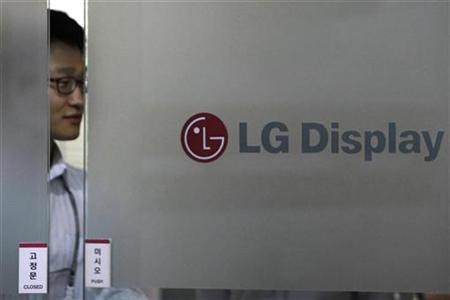 An employee of LG Display walks out of its Seoul office April 22, 2010. REUTERS/Jo Yong-Hak
