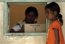 <p>A child waits to receive immunisation against tuberculosis with the vaccine, BCG, in Dili, East Timor, May 7, 2007. REUTERS/Beawiharta</p>