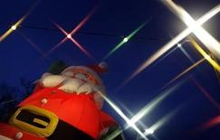 <p>A huge inflatable illuminated figure of Santa Claus is displayed as an advertisement for a Christmas tree seller in the village of Seeheim, about 40 km (25 mi) south of Frankfurt, December 9, 2009. REUTERS/Kai Pfaffenbach</p>