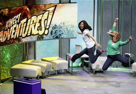 Assistants demonstrate the game ''Kinect Adventures'' for Kinect for Xbox 360 during a media briefing at the Wiltern theatre in Los Angeles June 14, 2010. REUTERS/Mario Anzuoni
