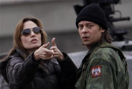 Actress Angelina Jolie talks to actor Goran Jetvic during the filming of her yet untitled directorial debut in Esztergom (60km north of Budapest) on November 12, 2010. REUTERS/Laszlo Balogh