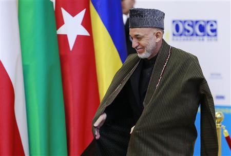Afghanistan's President Hamid Karzai arrives at the Organisation for Security and Cooperation in Europe (OSCE) Summit in Astana December 1, 2010. REUTERS/Francois Lenoir
