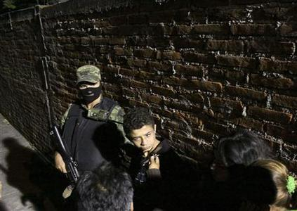 Edgar Jimenez Lugo (C) alias ''El Ponchis'' talks to a journalist as he is presented to the media in Cuernavaca December 3, 2010. REUTERS/Margarito Perez