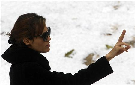 Actress Angelina Jolie gestures during the filming of her yet untitled directorial debut in Budapest November 8, 2010. REUTERS/Laszlo Balogh (HUNGARY - Tags: ENTERTAINMENT)