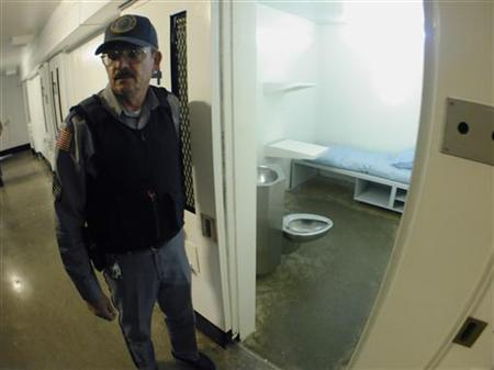 Death Row guard Sgt. James Ludwig stands outside a cell November 21, 2001 in ''A'' Pod, ''F'' section of Texas' death row located 75 miles northeast of Houston in Livingston, Texas. REUTERS/Richard Carson
