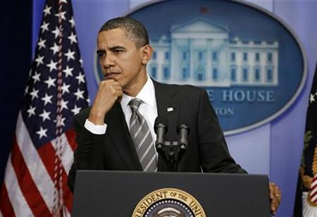 U.S. President Barack Obama listens to a question from a reporter during his news conference in the Brady Press Room of the White House in Washington, December 7, 2010. REUTERS/Larry Downing