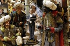<p>A figure of Wikileaks founder Julian Assange is placed in a Neapolitan Christmas creche by Gennaro Di Virgilio depicting the Nativity of Jesus in Naples, December 6, 2010. In recent decades, artists and craftsmen who make Neapolitan creches have used them to portray the signs of the times. Assange, who is depicted holding his trusty laptop, was created by Di Virgilio, who each year chooses at least one contemporary character to sculpt and place near the scenes of the traditional story of Jesus' birth in a manger. There is only one copy of Assange statuette which costs around 130 euros. This year, the southern city's garbage crisis also has become a recurring theme among the artists and craftsmen whose shops, along the narrow Via San Gregorio Armeno street, specialise in Christmas statues, creches and trinkets all year. REUTERS/Ciro De Luca</p>