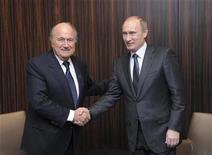 <p>Russia's Prime Minister Vladimir Putin (R) shakes hands with FIFA President Sepp Blatter in a hotel after the announcement that Russia will host the FIFA World Cup 2018 in Zurich December 2, 2010. REUTERS/FIFA/Pool</p>