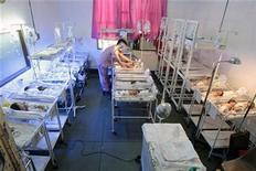 <p>A nurse takes care of a newly born baby inside a nursery station at a government Fabella hospital in Manila October 1, 2010. REUTERS/Romeo Ranoco</p>