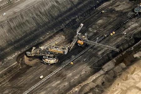 An aerial view shows excavators mine coal at the open-cast mining near Vattenfall's Jaenschwalde brown coal power station near Cottbus, eastern Germany August 8, 2010. REUTERS/Fabrizio Bensch