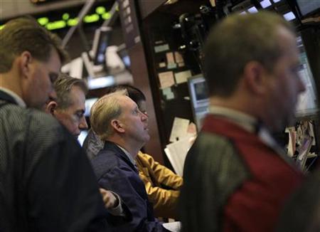 Traders work on the floor of the New York Stock Exchange December 2, 2010. REUTERS/Brendan McDermid