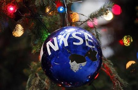 A cracked Christmas ornament with the New York Stock Exchange logo hangs from the Stock Exchange's official Christmas tree on Broad street outside the New York Stock Exchange December 9, 2008. REUTERS/Mike Segar