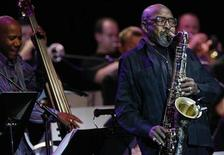 <p>Saxophonist James Moody performs next to bass player Nathan East during the Quincy Jones 75th Anniversary celebration gig at the 42nd Montreux Jazz Festival July 14, 2008. REUTERS/Denis Balibouse</p>