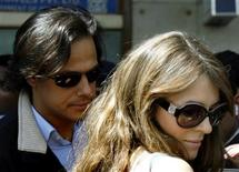 <p>Newly married British model Elizabeth Hurley (R) and Indian businessman Arun Nayar arrive at the international airport in Mumbai in this file photo taken March 5, 2007. REUTERS/Punit Paranjpe/Files</p>