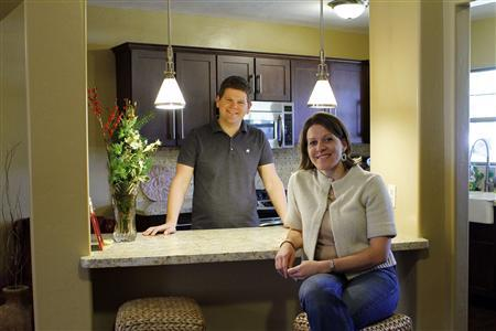 Beth Stiner and her husband Aaron Stiner poses for a portrait in the kitchen of their rental home in Phoenix, Arizona December 11, 2010. REUTERS/Joshua Lott