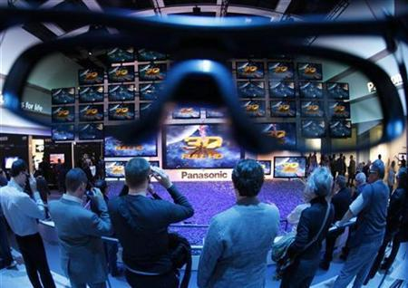 People watch a 3D presentation on a wall with television screens at the Panasonic stand at the Internationale Funkausstellung (IFA) consumer electronics fair at ''Messe Berlin'' exhibition centre in Berlin in this September 3, 2010 file photo. REUTERS/Christian Charisius