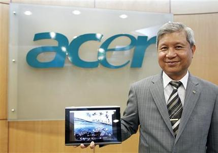 Acer's Chairman J.T. Wang poses with the new 10-inch Acer tablet PC after an interview with Reuters in Taipei December 14, 2010. Acer, the world's No.2 PC vendor, expects its China operations to make up more than 20 percent of its total sales in five years, helped by new tablet PCs and an alliance with China's Founder Technology. REUTERS/Pichi Chuang