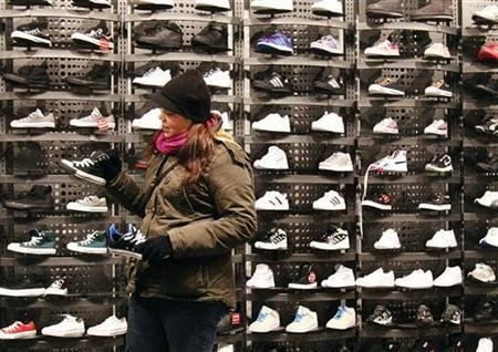 A woman shops for sneakers at a shoe store in New York December 14, 2010. REUTERS/Shannon Stapleton
