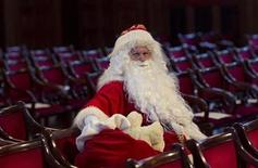 <p>A man dressed in a Santa Claus costume waits for the start of the annual meeting of participants of a university rent-a-Santa Claus service in Berlin November 27, 2010. Some 100 people in Santa Claus and fairy costumes met on Saturday in Berlin for a general meeting to launch the annual Student Union charitable Santa Claus rental campaign. REUTERS/Thomas Peter</p>