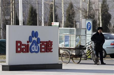 A security personnel stands near the logo of Baidu outside its headquarters in Beijing December 15, 2010. China's top search engine, Baidu Inc , sees its top-line and bottom-line growth rates softening over the next year on a higher base of comparison, as it eyes acquisitions and ''contextual'' ads to boost growth in the future. REUTERS/Soo Hoo Zheyang