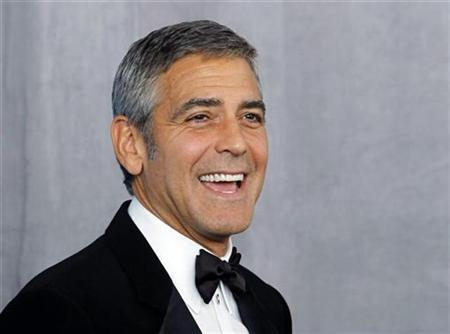 Actor George Clooney poses backstage after receiving the Bob Hope Humanitarian Award at the 62nd annual Primetime Emmy Awards in Los Angeles, California, August 29, 2010. REUTERS/Danny Moloshok