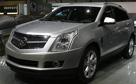 A Cadillac SRX is displayed during the first media day of the 79th Geneva Car Show at the Palexpo in Geneva March 3, 2009. General Motors Co has been working to develop a plug-in hybrid vehicle based on its Cadillac SRX crossover, two people with direct knowledge of the work said. REUTERS/Arnd Wiegmann