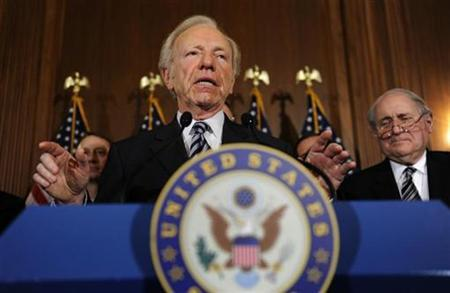 U.S. Senator Joseph Lieberman (I-CT) (C) and Senator Carl Levin (D-MI) (R) appear at a news conference after the passage of a procedure hurdle to lead to the probable repeal of the Don't Ask Don't Tell policy against homosexuals serving in the military, at the U.S. Capitol in Washington, December 18, 2010. REUTERS/Jonathan Ernst
