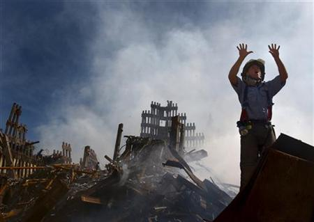 A New York City fireman calls for more rescue workers to make their way into the rubble of the World Trade Center September 15, 2001. REUTERS/HO/U.S. Navy Photo by Journalist 1st Class Preston Keres