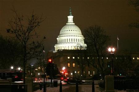 The Capitol Dome is lit after the first significant snowfall of the season as the House of Representatives worked late into the evening to pass the $858 billion package of renewed tax cuts and more unemployment benefits in Washington, December 16, 2010.REUTERS/Hyungwon Kang