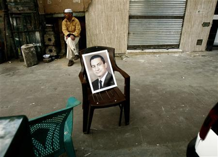 A picture of Egyptian President Hosni Mubarak is seen on a plastic chair in downtown Cairo in this March 26, 2007 file photo. Egypt used to be the undisputed Arab power. In the 1950s and 60s, Nasser electrified Arabs with his defiance of colonial powers, enmity for Israel and heady brand of Arab nationalism and socialism. Western powers loathed him, just as today they revile Iranian leader Mahmoud Ahmadinejad and his ''resistance'' rhetoric. President Hosni Mubarak, 82, who has ruled Egypt for almost 30 years and may well stand for a sixth term next year, has preserved the peace treaty with Israel and stuck solidly in the U.S. camp. What he lacks, says Amr Hamzawy, an analyst at the Carnegie Endowment's Middle East Centre, is ''the vision component. Mubarak is not a visionary leader and is too old to become one.'' REUTERS/Goran Tomasevic/Files