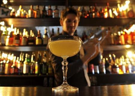 A bartender mixes a cocktail in this December 3, 2010 file photo. REUTERS/Toby Melville