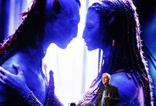 "<p>Film director and Lightstorm Entertainment Chairman James Cameron delivers a keynote address titled ""Renaissance now in imagination and technology"" in front of an image of his movie ""Avatar"" during the Seoul Digital Forum 2010 May 13, 2010. REUTERS/Jo Yong-Hak</p>"