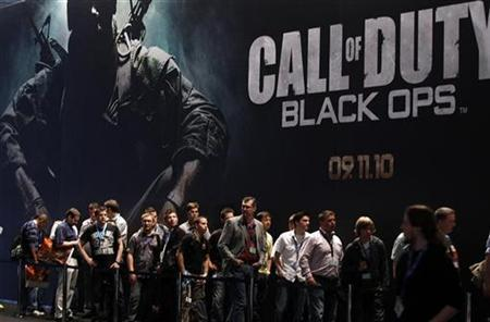 Visitors wait at an exhibition stand for 'Call of Duty - Black Ops' at the Gamescom 2010 fair in Cologne in this August 18, 2010 file photo. REUTERS/Ina Fassbender