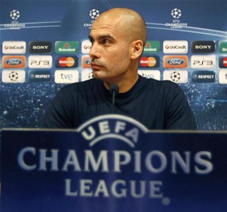 Barcelona's coach Pep Guardiola reacts during a news conference at Nou Camp stadium in Barcelona, December 6, 2010. ainst Rubin Kazan on Tuesday. REUTERS/Gustau Nacarino