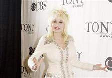 "<p>Singer Dolly Parton, nominated for a Tony Award for ""Best Original Score"" for her work in ""9 to 5: The Musical"", arrives for a press reception in New York May 6, 2009. REUTERS/Lucas Jackson</p>"