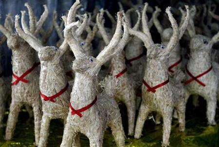 Reindeers made from straw and wood are displayed for sale at a stall in downtown San Salvador in preparation for Christmas November 30, 2010. REUTERS/Luis Galdamez