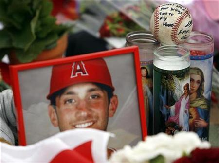 A baseball with a note on it is seen among other items at a memorial for Los Angeles Angels pitcher Nick Adenhart at Angel Stadium, before the game between the Los Angeles Angels and the Boston Red Sox in Anaheim, California, in this April 10, 2009 file photo. REUTERS/Danny Moloshok/Files