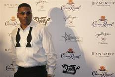 <p>Hip Hop star Nelly stands on the red carpet at the 5th annual Black & White Ball in St. Louis, Missouri December 19, 2010 in this publicity photo released to Reuters December 22, 2010. REUTERS/Jeff Wilson/SYNERGY/Handout</p>