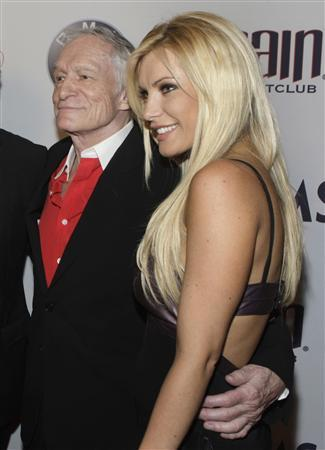Playboy magazine founder Hugh Hefner and girlfriend, British-American model and singer Crystal Harris pose at the Palms Casino Resort in Las Vegas, Nevada in this May 15, 2010 file photograph. REUTERS/Steve Marcus/Files